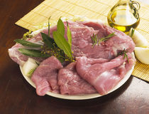 Turkey meat. Slices of turkey meat with laurel and olive oil Stock Photography