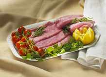 Turkey meat. With little tomatoes, lemon, rosemary and salad Royalty Free Stock Image