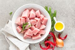 Turkey meat sliced and ingredients for cooking on light grey stone background Stock Photos
