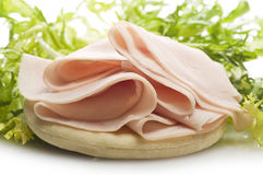 Turkey meat slices. With salad on the white Stock Image