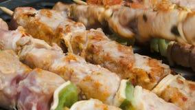 Turkey meat on sticks flips on a grill. Turkey meat on wooden sticks flips on a grill stock video