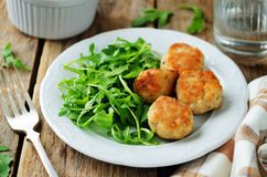 Turkey meatballs with arugula. On a wood background. toning. selective focus royalty free stock images
