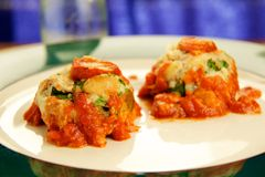 Turkey Meatballs with Sauce. Homemade turkey meatballs smothered in tomato sauce Royalty Free Stock Images