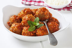 Turkey Meatballs. In tomato sauce with a spoon royalty free stock image