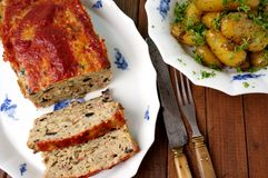 Turkey meatloaf with roasted potatoes served on Royal Copenhagen Royalty Free Stock Image
