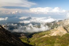 Turkey mountais vith the clouds. Summer  day on mountain with the clouds on a hight peak Turkey Stock Photo