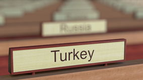 Turkey name sign among different countries plaques at international organization. 3D rendering Royalty Free Stock Photography