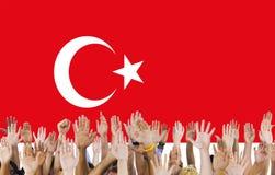 Turkey National Flag People Hand Raised Concept stock photo