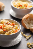Turkey Noodle Soup with piping hot rolls Stock Photography