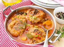 Turkey ossobuco osso bucco in tomato gravy with mushrooms Royalty Free Stock Images