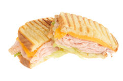 Turkey Panini. A turkey panini with cheddar cheese on a white background Stock Image