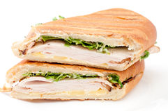 Turkey panini sandwich. Turkey panini with arugula and cheddar cheese Stock Images