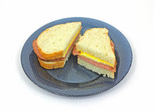 Turkey Pastrami Sandwich on Blue Plate Royalty Free Stock Photography