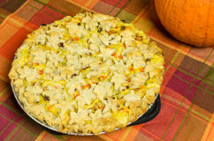 Turkey pot pie with pumpkin on table Stock Photo