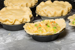 Turkey pot pies being prepared in a kitchen Stock Photo
