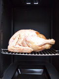 Turkey in a propane smoker Royalty Free Stock Image