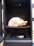 Turkey in a propane smoker Stock Photo