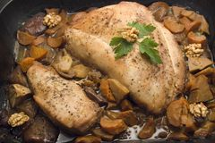 Turkey roast. Turkey dinner steak in a tray with vegetables and nuts Stock Images