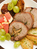 Turkey roulade. Roasted turkey roulade with potatoes, garlic and fruits. Viewed from above Stock Photos