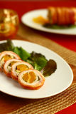 Turkey roulade with abricot. Turkey breast rolls (roulades) with abricot wrapped in bacon Stock Photo