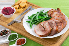 Turkey roulade cut in slices with boiled green beans, close-up Royalty Free Stock Photography
