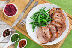 Turkey roulade cut in slices with boiled green beans Royalty Free Stock Photo