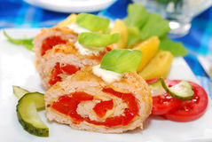 Turkey roulade stuffed with cheese and red pepper. Baked turkey roulade stuffed with cheese and red pepper for dinner Royalty Free Stock Image