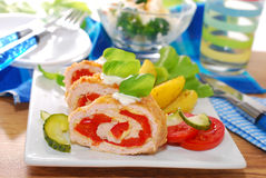 Turkey roulade stuffed with cheese and red pepper. Baked turkey roulade stuffed with cheese and red pepper for dinner Stock Photo