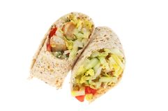 Turkey and salad wraps. Turkey and salad sandwich wraps isolated against white Royalty Free Stock Photo