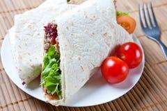 Turkey, salad, and stuffing wraps Stock Photos