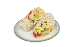 Turkey and salad wraps. Turkey and salad sandwich wraps on a plate isolated against white Stock Photo