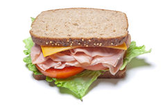 Turkey Sandwich. A turkey sandwich with lettuce, tomatoes, cheese on whole grain bread isolated on white Stock Photography