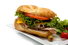 A turkey sandwich on a croissant Royalty Free Stock Photography