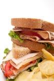 Turkey sandwich with potato chips. Turkey sandwich meal with potato chips Stock Photos