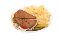 Turkey sandwich with potato chips Stock Photos
