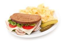 Turkey sandwich with potato chips Stock Photography