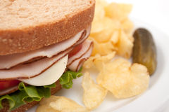 Turkey sandwich with potato chips Stock Images