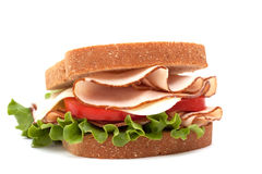 Turkey sandwich on wheat bread Royalty Free Stock Photos
