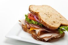 Turkey sandwich on white background Royalty Free Stock Photos