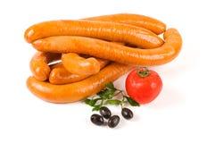 Turkey sausages on white Royalty Free Stock Photos