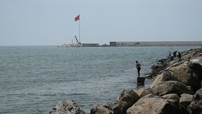 Sea water port coast shore and fishermen. Turkey sea port of Zonguldak Eregli also holds water and fish fisher stock footage