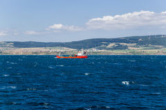 Turkey. Seascape with cargo ship in the Strait of Dardanelles Royalty Free Stock Photo