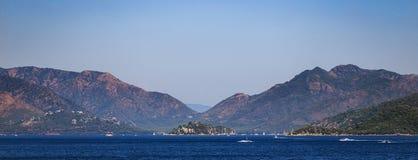 Turkey seashore, white sand seacoast, mediterranean sea, a ship in the water, summer vacation Royalty Free Stock Photo