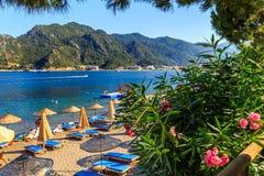 Turkey seashore, white sand seacoast, mediterranean sea, a ship in the water, summer vacation Stock Photography