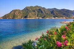 Turkey seashore, white sand seacoast, mediterranean sea, a ship in the water, summer vacation Royalty Free Stock Photos