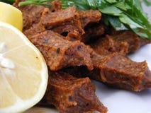 Turkey seasoned spicy dumplings with lemon and marinas Royalty Free Stock Images