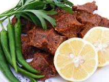 Turkey seasoned spicy dumplings with lemon and marinas Royalty Free Stock Image
