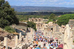 Turkey/Selçuk: Tourism in Ephesus. These tourists are headed down Efes Harabeleri towards the main attraction of the archeological site, the Library of Celsus Royalty Free Stock Photo