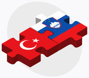 Turkey and Slovenia Flags in puzzle isolated on white background Royalty Free Stock Photography