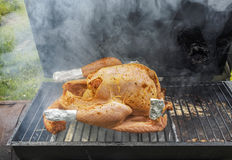 Turkey on a smoker Royalty Free Stock Photos